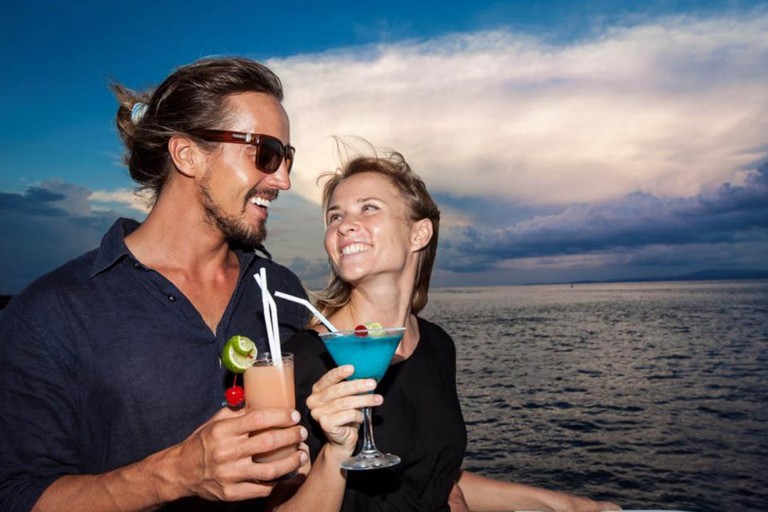 Enjoy a welcome cocktail on board luxury cruise.